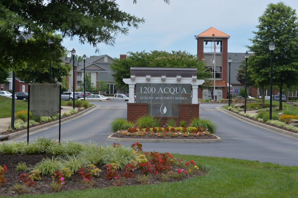 Entrance Sign at 1200 Acqua