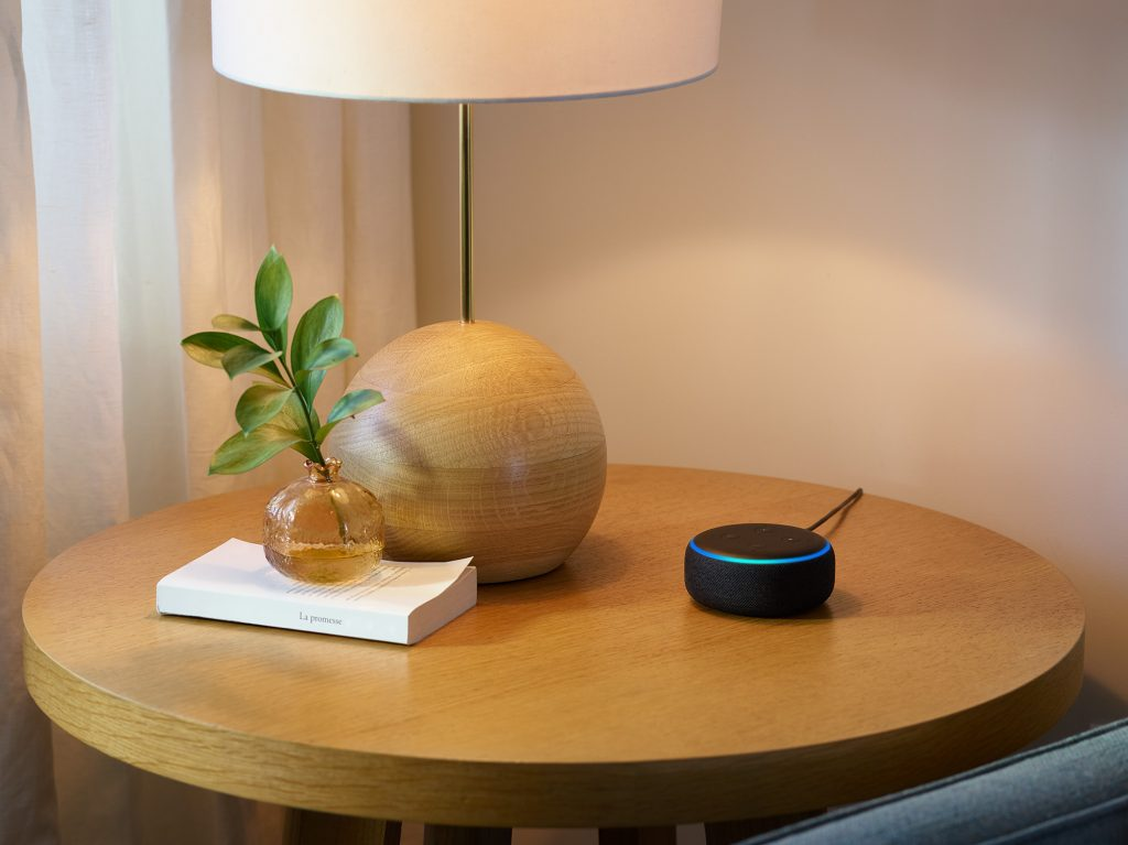 Echo Dot sitting on a side table