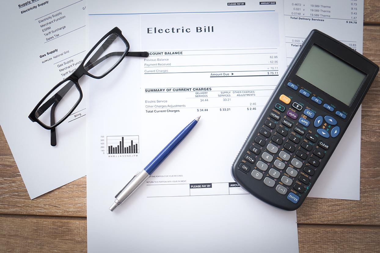 View of utility bills and calculator