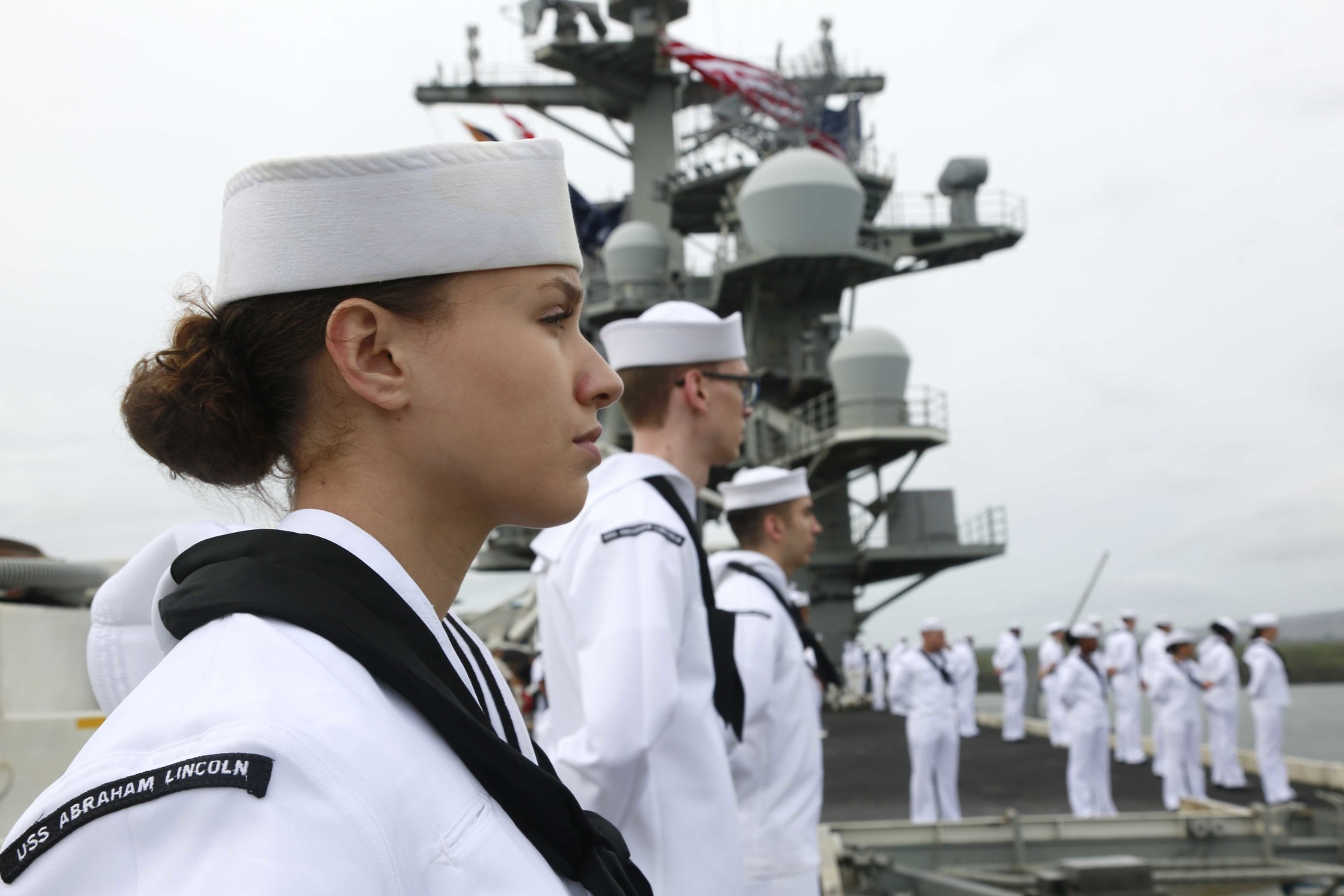 Sailors man the rails of the aircraft carrier USS Abraham Lincoln as the ship pulls out of Joint Base Pearl Harbor-Hickam, Hawaii, following a scheduled port visit, Jan. 14, 2020.